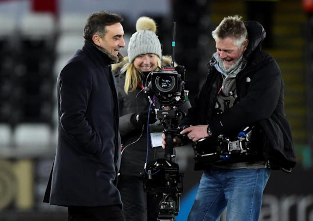 Soccer Football - FA Cup Fourth Round Replay - Swansea City vs Notts County - Liberty Stadium, Swansea, Britain - February 6, 2018 Swansea City manager Carlos Carvalhal and a camera crew after the match REUTERS/Rebecca Naden