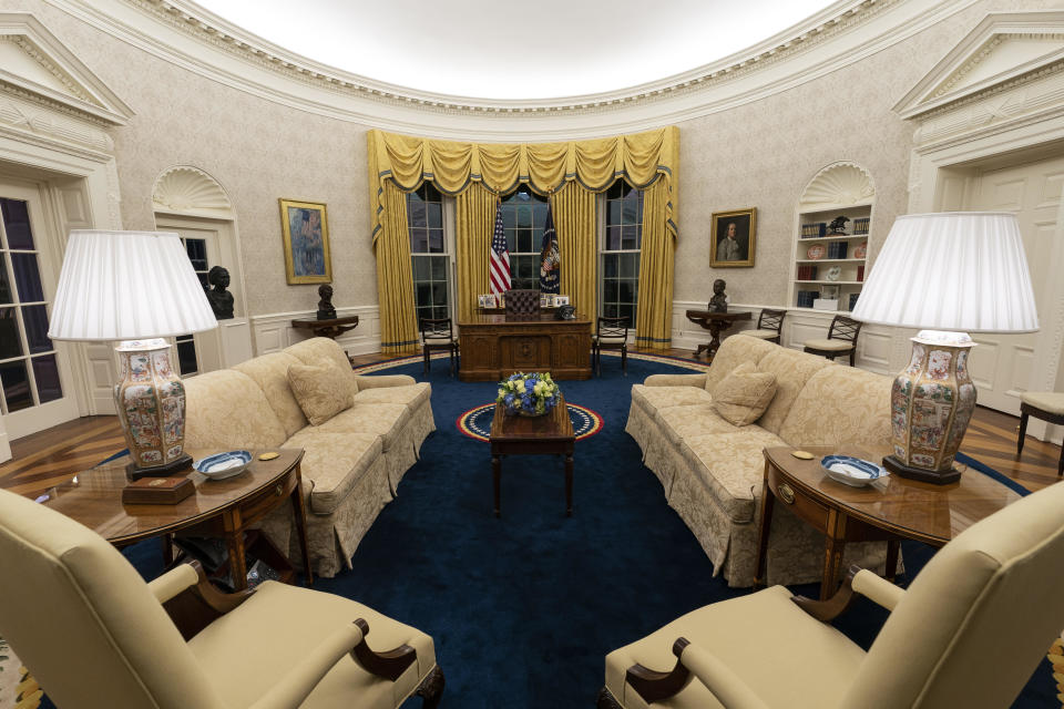 The Oval Office of the White House is newly redecorated for the first day of President Joe Biden's administration, Wednesday, Jan. 20, 2021, in Washington. / Credit: Alex Brandon/AP