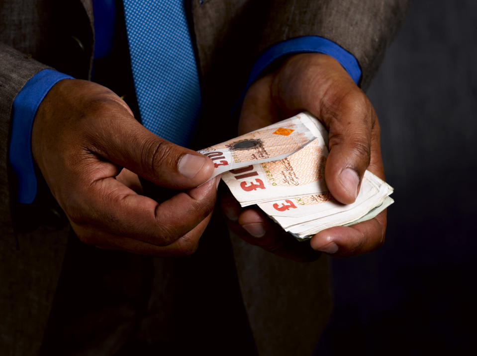 <em>What's more important, loving your job or earning lots of money? (Picture: Getty)</em>