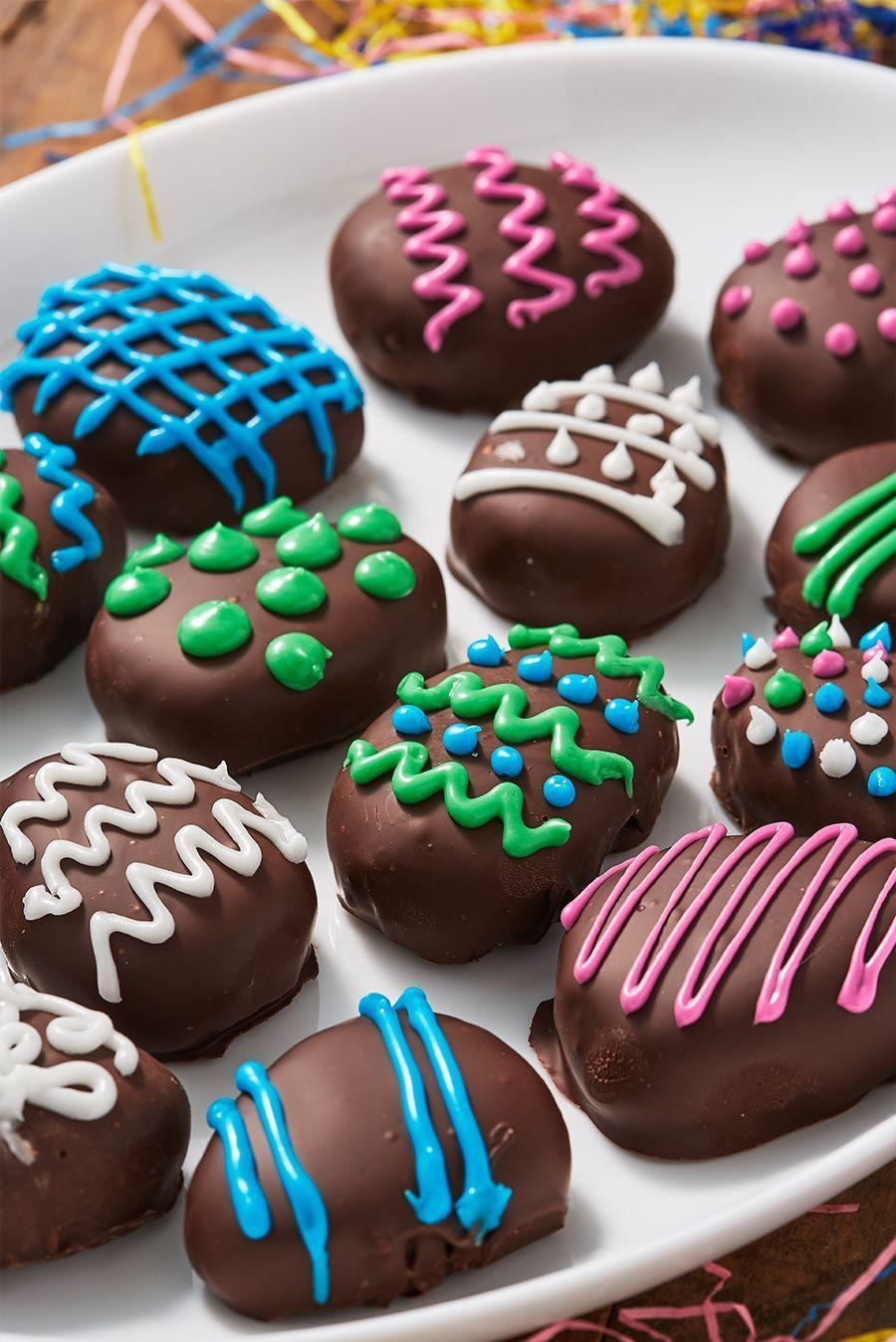 """<p>Win at Easter with these <a href=""""https://www.delish.com/uk/cooking/recipes/a30377008/oreo-truffles-recipe/"""" rel=""""nofollow noopener"""" target=""""_blank"""" data-ylk=""""slk:Oreo truffles"""" class=""""link rapid-noclick-resp"""">Oreo truffles</a>. Decorate them however you want for the cutest eggs at the table! </p><p>Get the <a href=""""https://www.delish.com/uk/cooking/recipes/a32091977/easter-egg-oreo-truffles-recipe/"""" rel=""""nofollow noopener"""" target=""""_blank"""" data-ylk=""""slk:Easter Egg Oreo Truffles"""" class=""""link rapid-noclick-resp"""">Easter Egg Oreo Truffles</a> recipe.</p>"""