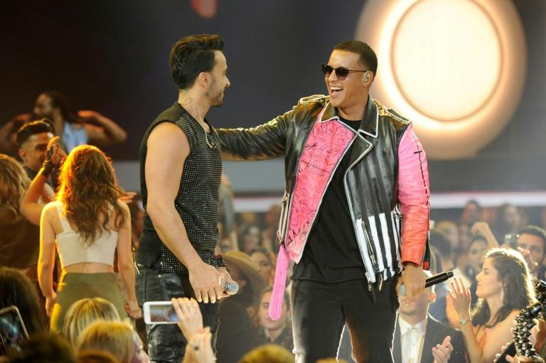 "Daddy Yankee (right), pictured in this April 27, 2017 file photo with Luis Fonsi, attributes the hip-shaking popularity of his latest song ""Dura"" to ""the magic of music"""