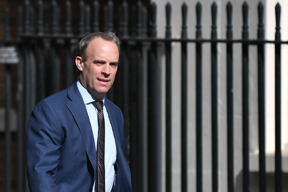 Britain's Foreign Secretary Dominic Raab arrives in Downing Street in central London on May 7, 2020 for the daily novel coronavirus COVID-19 briefing. - The British government was on May 7 reviewing lockdown measures introduced to combat the coronavirus outbreak, with a partial easing expected to be announced this weekend. (Photo by DANIEL LEAL-OLIVAS / AFP) (Photo by DANIEL LEAL-OLIVAS/AFP via Getty Images)