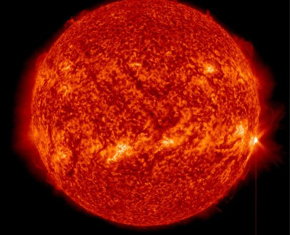 A full-disk view of the sun as an X1.3-class solar flare (far right) erupts on April 24, 2014 EDT (April 25 GMT).