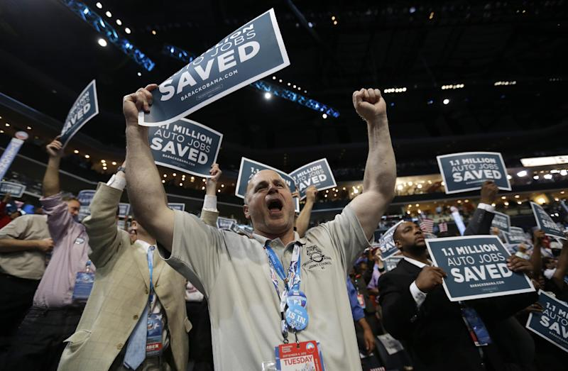 Delegates cheer as Former President Bill Clinton arrives to address the Democratic National Convention in Charlotte, N.C., on Wednesday, Sept. 5, 2012. (AP Photo/David Goldman)