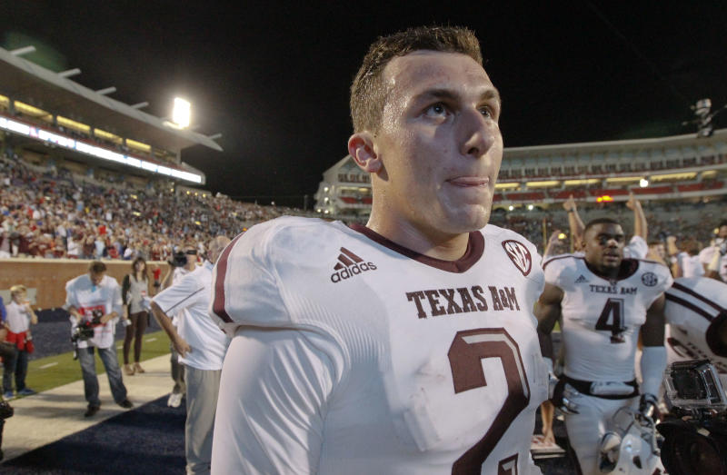 Texas A&M quarterback Johnny Manziel (2) looks into the stands for fans after he and his team defeated Mississippi in their NCAA college football game at Vaught-Hemingway Stadium in Oxford, Miss., Saturday, Oct. 12, 2013. No. 9 Texas A&M won 41-38. (AP Photo/Rogelio V. Solis)