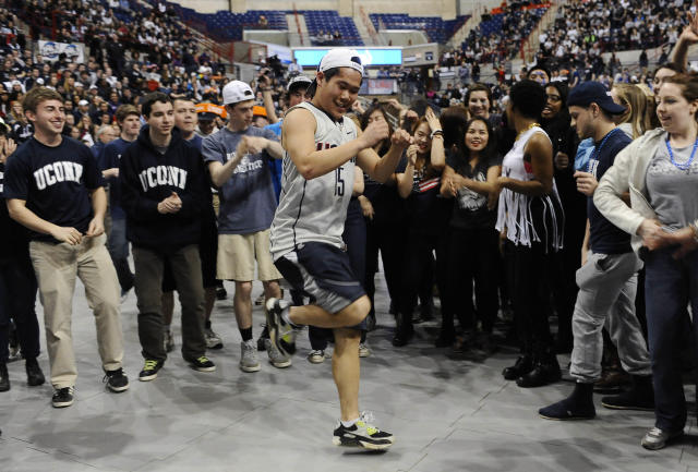 Hardy Chen of Farmington, Conn. dances at halftime during the broadcast of the UConn and Notre Dame women's basketball game for the NCAA title, Tuesday, April 8, 2014, in Storrs, Conn