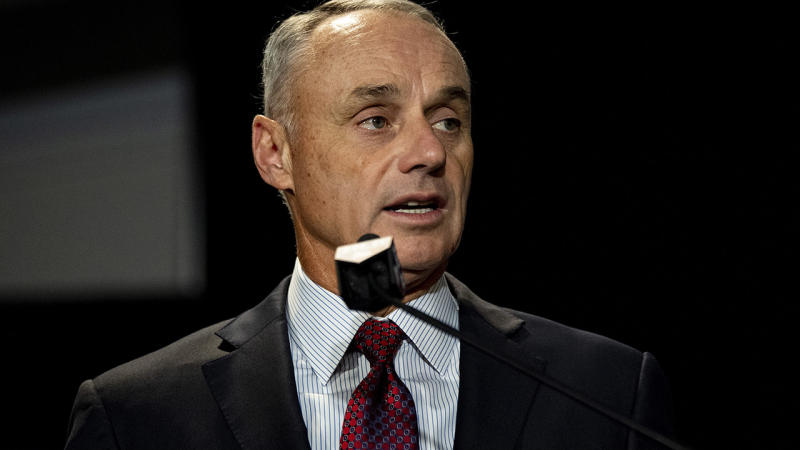 Rob Manfred, pictured here speaks to the media in 2018.