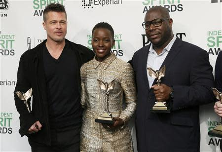 """Producer Brad Pitt, actress Lupita Nyong'o and director Steve McQueen pose with their awards for """"12 Years a Slave"""" backstage at the 2014 Film Independent Spirit Awards in Santa Monica, California March 1, 2014. REUTERS/Danny Moloshok"""