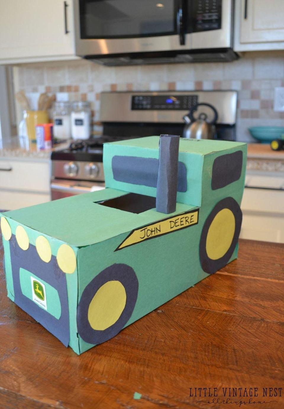 "<p>Two boxes team up to form the frame of this John Deere Valentine's Day box fit for boys and girls growing up in the country.</p><p><strong>Get the tutorial at <a href=""https://sarahjoyblog.com/tractor-valentines-day-box/"" rel=""nofollow noopener"" target=""_blank"" data-ylk=""slk:Sarah Joy Blog"" class=""link rapid-noclick-resp"">Sarah Joy Blog</a>.</strong></p><p><strong><a class=""link rapid-noclick-resp"" href=""https://www.amazon.com/Glue-Sticks/b?ie=UTF8&node=1068996&tag=syn-yahoo-20&ascsubtag=%5Bartid%7C10050.g.25844424%5Bsrc%7Cyahoo-us"" rel=""nofollow noopener"" target=""_blank"" data-ylk=""slk:SHOP GLUE STICKS"">SHOP GLUE STICKS</a><br></strong></p>"