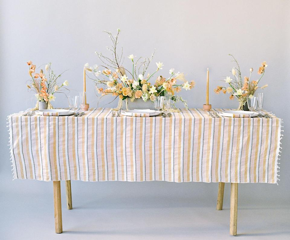 "<p><strong>–</strong></p><p>heathertaylorhome.com</p><p><strong>$186.00</strong></p><p><a href=""https://heathertaylorhome.com/shop/amalfi-goldenrod-tablecloth/"" rel=""nofollow noopener"" target=""_blank"" data-ylk=""slk:Shop Now"" class=""link rapid-noclick-resp"">Shop Now</a></p><p>Handwoven in Mexico, this 100% cotton striped tablecloth is modern and fresh while staying true to the colors of the season.</p>"