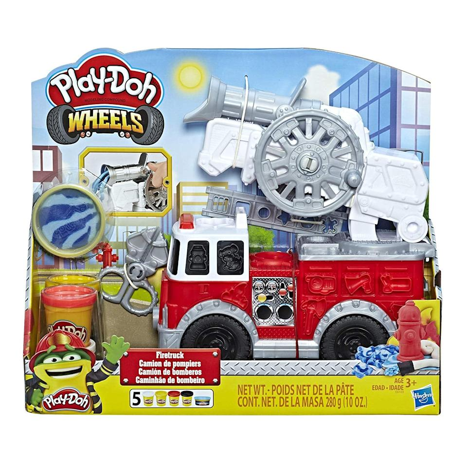 "<p><a href=""https://www.popsugar.com/buy/Play-Doh-Wheels-Firetruck-Toy-5-Non-Toxic-Colors-Including-Play-Doh-Water-Compound-488272?p_name=Play-Doh%20Wheels%20Firetruck%20Toy%20with%205%20Non-Toxic%20Colors%20Including%20Play-Doh%20Water%20Compound&retailer=amazon.com&pid=488272&price=20&evar1=moms%3Aus&evar9=46581978&evar98=https%3A%2F%2Fwww.popsugar.com%2Ffamily%2Fphoto-gallery%2F46581978%2Fimage%2F46585239%2FPlay-Doh-Wheels-Firetruck-Toy-with-5-Non-Toxic-Colors-Including-Play-Doh-Water-Compound&list1=amazon%2Ctoys%2Cgift%20guide%2Ckids%20toys%2Cgifts%20for%20toddlers&prop13=api&pdata=1"" rel=""nofollow"" data-shoppable-link=""1"" target=""_blank"" class=""ga-track"" data-ga-category=""Related"" data-ga-label=""https://www.amazon.com/dp/B07MV23M12/ref=cm_gf_aht_iaaa_d_p0_c0_qd0__________________cL1A8Vedu9TMgNlDTsy7"" data-ga-action=""In-Line Links"">Play-Doh Wheels Firetruck Toy with 5 Non-Toxic Colors Including Play-Doh Water Compound</a> ($20)</p>"