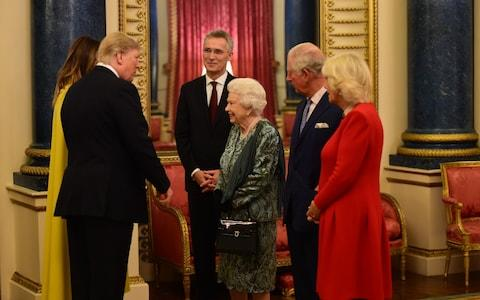 <span>The Trumps greet the Queen at Buckingham Palace</span> <span>Credit: Geoff Pugh for the Telegraph </span>
