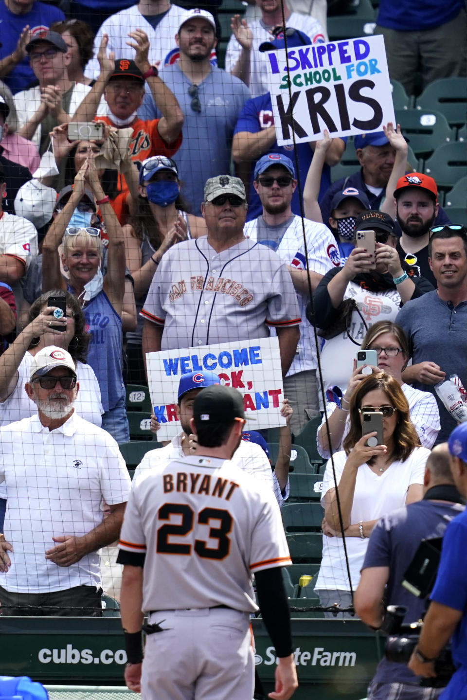 Chicago Cubs fans greet San Francisco Giants' Kris Bryant (23) before a baseball game in Chicago, Friday, Sept. 10, 2021. (AP Photo/Nam Y. Huh)