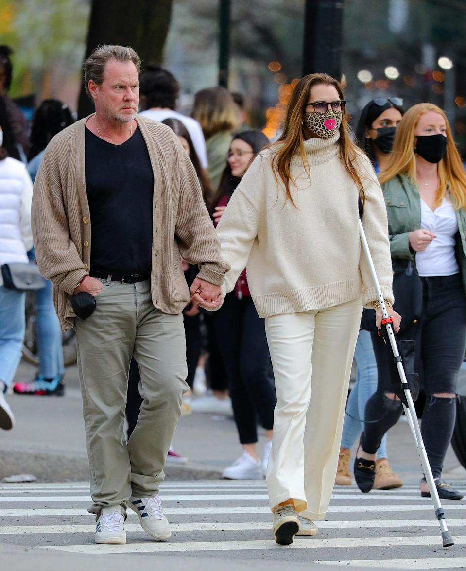"<p>Brooke Shields — <a href=""https://people.com/health/brooke-shields-accident-struggle-walk-again/"" rel=""nofollow noopener"" target=""_blank"" data-ylk=""slk:still mending her broken femur"" class=""link rapid-noclick-resp"">still mending her broken femur</a> — and husband Chris Henchy walk hand-in-hand through New York City over the weekend.</p>"