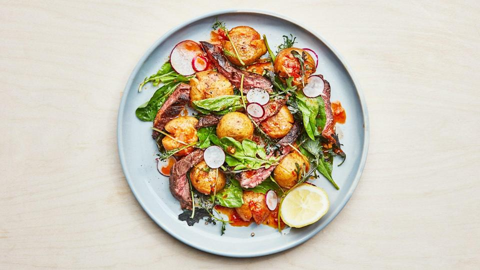 """<a href=""""https://www.bonappetit.com/recipe/steak-salad-with-harissa-potatoes-and-crunchy-radishes?mbid=synd_yahoo_rss"""" rel=""""nofollow noopener"""" target=""""_blank"""" data-ylk=""""slk:See recipe."""" class=""""link rapid-noclick-resp"""">See recipe.</a>"""