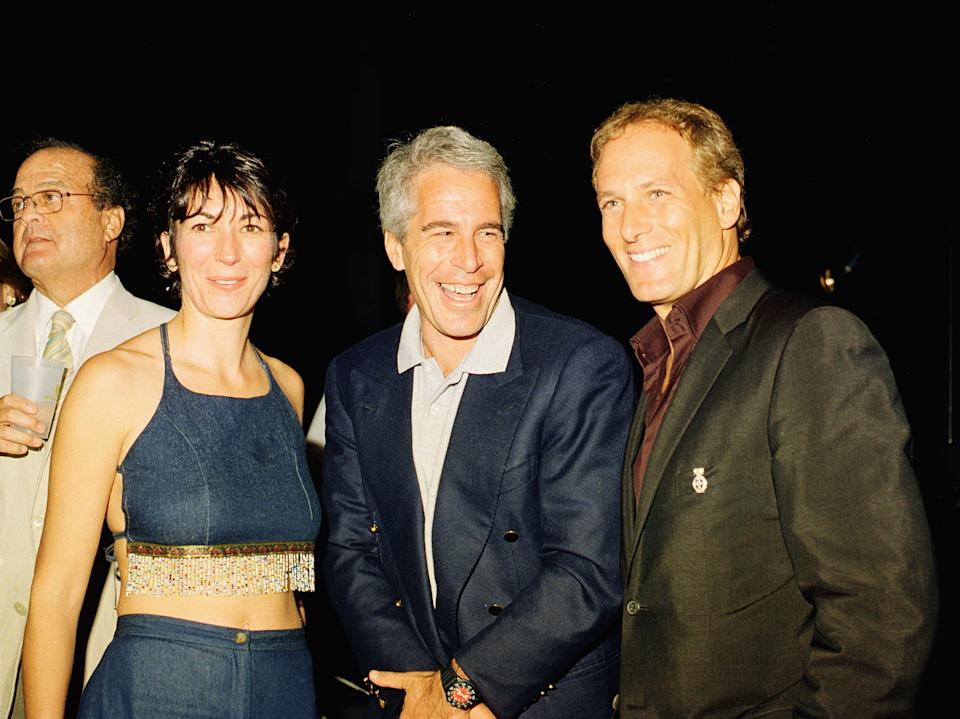 (L-R) Ghislaine Maxwell, Jeffrey Epstein, and musician Michael Bolton pose for a portrait during a party at the Mar-a-Lago club, Palm Beach, Florida, February 12, 2000. (Photo by Davidoff Studios/Getty Images)