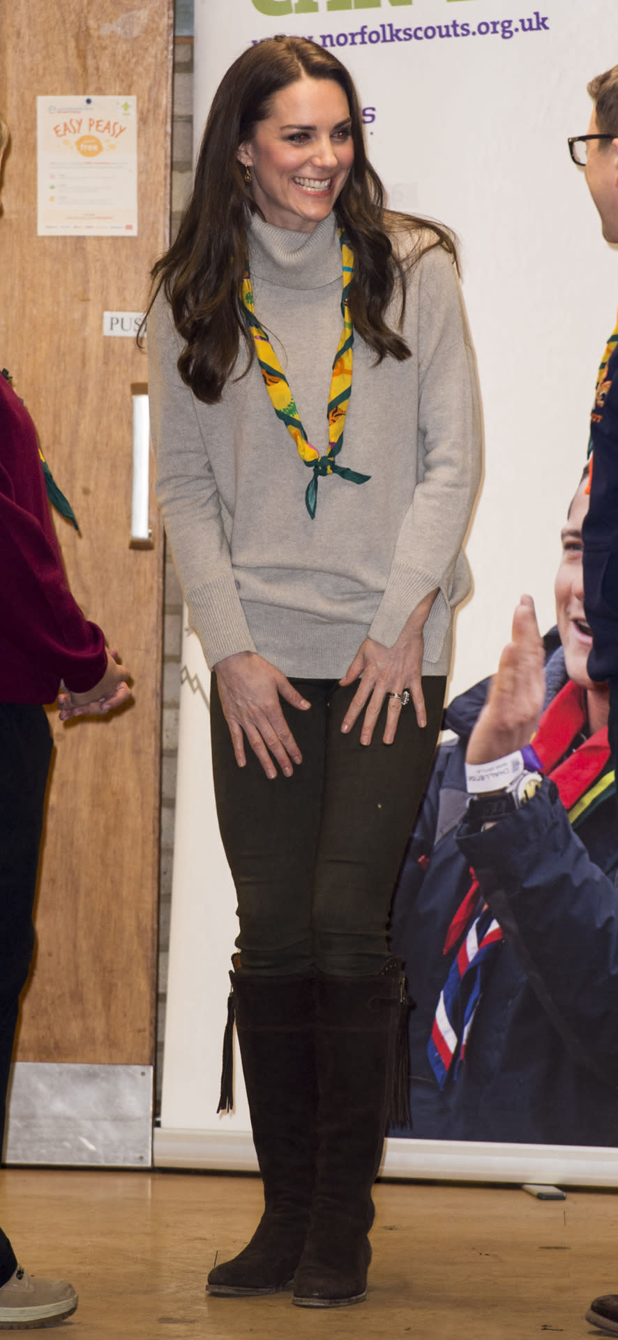 <p>During a visit to the Cub Scouts' King Lynn District meeting space, for the organisation's centenary celebrations, the Duchess made sure she looked the part by donning the traditional necktie members sport. Kate, who was was a Brownie herself 26 years ago, wore the neckerchief over a £170 cashmere turtleneck from Iris and Ink and skinny jeans, paired with her trusty Real Wild Clothing boots that she's worn on a number of occasions. </p><p><i>[Photo: Getty]</i></p>