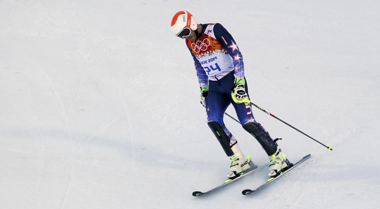 Bode Miller of the U.S. reacts after the slalom run of the men's alpine skiing super combined event at the 2014 Sochi Winter Olympics at the Rosa Khutor Alpine Center February 14, 2014. REUTERS/Stefano Rellandini (RUSSIA - Tags: SPORT SKIING OLYMPICS)