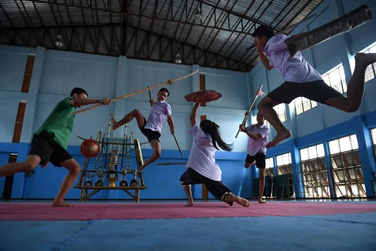 """The fighters are part of a growing group of students learning the martial art of """"Krabi Krabong"""" (AFP Photo/Lillian SUWANRUMPHA)"""