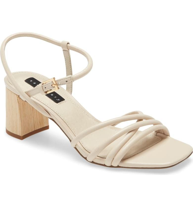 """<p>These <a href=""""https://www.popsugar.com/buy/Sanctuary-Break-Sandals-553154?p_name=Sanctuary%20Break%20Sandals&retailer=shop.nordstrom.com&pid=553154&price=109&evar1=fab%3Aus&evar9=47269950&evar98=https%3A%2F%2Fwww.popsugar.com%2Fphoto-gallery%2F47269950%2Fimage%2F47270583%2FSanctuary-Break-Sandals&list1=shopping%2Cnordstrom%2Ceditors%20pick%2Cspring%2Cspring%20fashion%2Cfashion%20shopping&prop13=api&pdata=1"""" rel=""""nofollow"""" data-shoppable-link=""""1"""" target=""""_blank"""" class=""""ga-track"""" data-ga-category=""""Related"""" data-ga-label=""""https://shop.nordstrom.com/s/break-sandal/5585474/full?origin=category-personalizedsort&amp;breadcrumb=Home%2FWomen%2FNew%20Arrivals&amp;color=bone%20leather"""" data-ga-action=""""In-Line Links"""">Sanctuary Break Sandals</a> ($109) go with everything.</p>"""