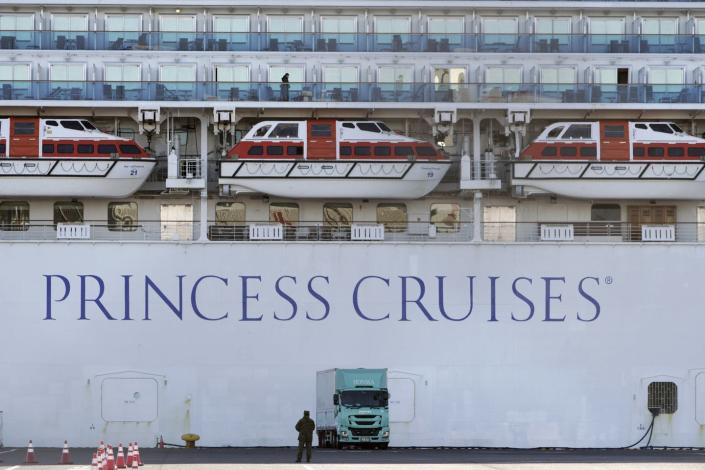 """<span class=""""caption"""">A quarantined cruise ship in Japan at the Yokohama Port in Yokohama, near Tokyo, Feb. 9, 2020. Cruise and airline bookings are down as a result of the coronavirus.</span> <span class=""""attribution""""><a class=""""link rapid-noclick-resp"""" href=""""http://www.apimages.com/metadata/Index/Japan-China-Outbrake/d48fb1d4ee4b4aecb2267ba27201a1ca/58/0"""" rel=""""nofollow noopener"""" target=""""_blank"""" data-ylk=""""slk:AP Photo/Eugene Hoshiko"""">AP Photo/Eugene Hoshiko</a></span>"""