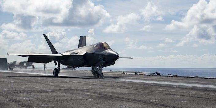 """An F-35C Lightning II, assigned to the """"Argonauts"""" of Strike Fight Squadron (VFA) 147, launches off the flight deck aboard Nimitz-class aircraft carrier USS Carl Vinson"""