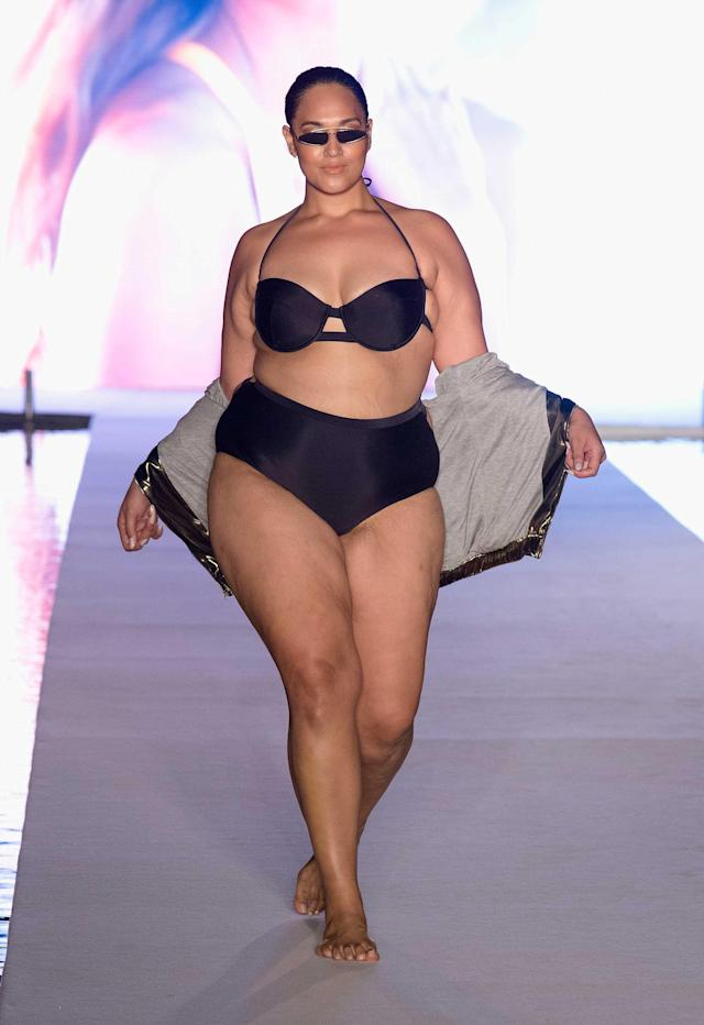 <p>A model walks the runway wearing trendy tiny sunglasses and a black bikini set for the swimsuit show during the Paraiso Fashion Fair in Miami at the W South Beach hotel on July 15. (Photo: Alexander Tamargo/Getty Images for Sports Illustrated) </p>
