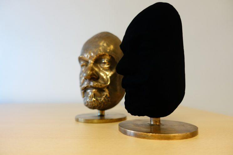 A bust covered in Vantablack compared to the original bust. Photo from Surrey NanoSystems
