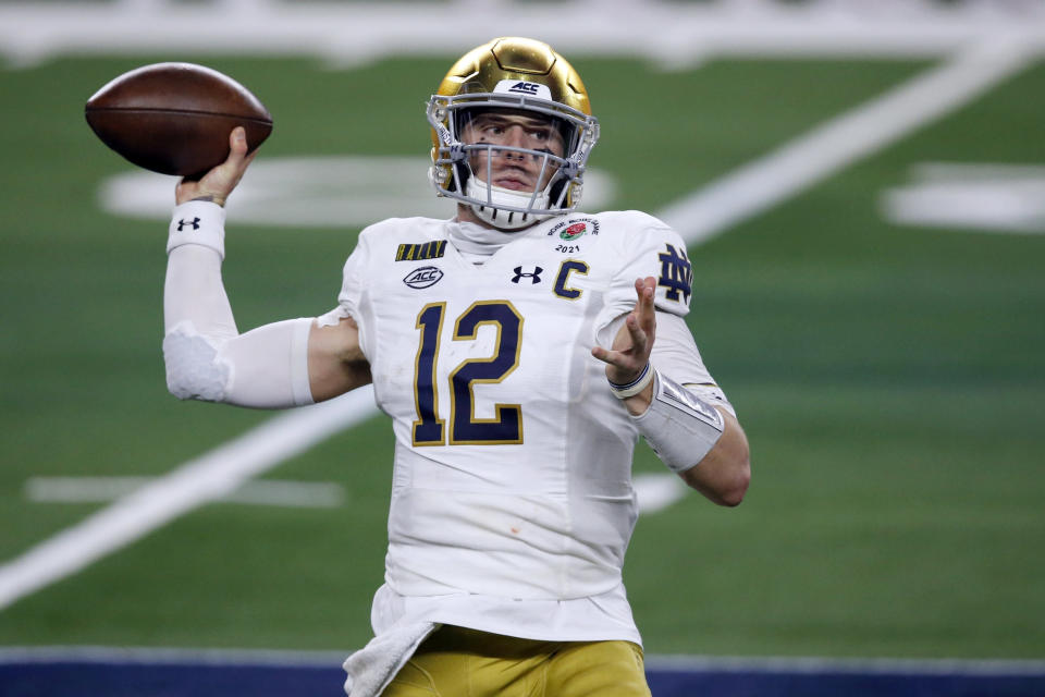 FILE - In this Jan. 1, 2021, file photo, Notre Dame quarterback Ian Book (12) throws a pass in the first half of the Rose Bowl NCAA college football game against Alabama in Arlington, Texas. Perhaps the best-known collegian selected in the fourth round Saturday was Book. And Book went somewhere with a QB opening: New Orleans, which saw career passing leader Drew Brees retire. (AP Photo/Roger Steinman, File)