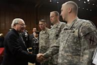 Former Sen. Carl Levin shakes hands with members of the army prior to the start of the committee's hearing on the Army's fiscal 2008 budget.