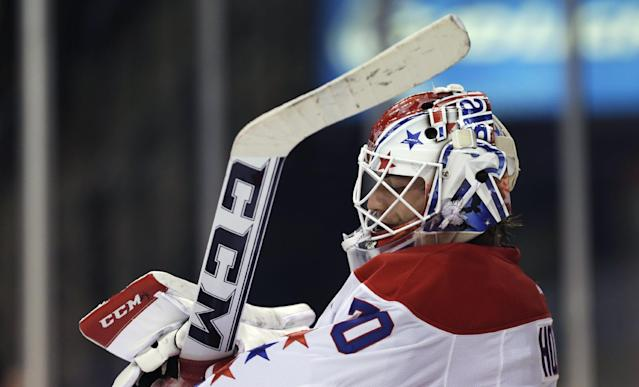 Washington Capitals goalie Braden Holtby adjusts his gloves after giving up a goal to the Boston Bruins during the second period of an NHL hockey game, Thursday, March 6, 2014, in Boston. (AP Photo/Charles Krupa)