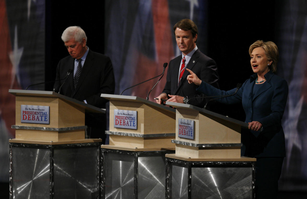In this photo taken Dec. 13, 2007, Democratic presidential hopeful Sen. Hillary Clinton, D-N.Y. speaks at right as Democratic presidential hopeful Sen. Christopher Dodd, D-Conn. and Democratic presidential hopeful former Sen. John Edwards, D-N.C. listen during the Des Moines Register Democratic Presidential Debate in Johnston, Iowa. Hillary Clinton has appeared in more than 30 primary debates during her two presidential campaigns, a deep history she can draw upon as she faces Donald Trump on Monday, Sept. 26, 2016. Clinton has been through the debate gauntlet in two New York Senate campaigns as well as in presidential primary match-ups against then-Sen. Barack Obama in 2008, Vermont Sen. Bernie Sanders this year and other challengers. (AP Photo/Charlie Neibergall)