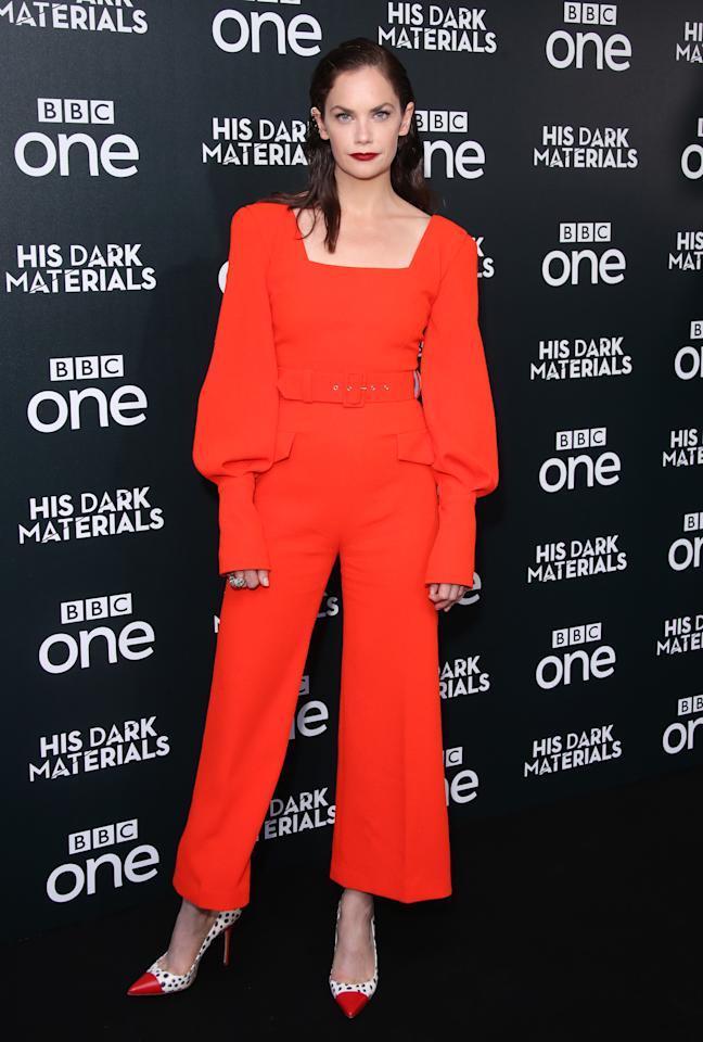 The former 'Luther' actress wears a red Emilia Wickstead jumpsuit, completed with oversized sleeves and a matching belt. <em>[Photo: Getty]</em>