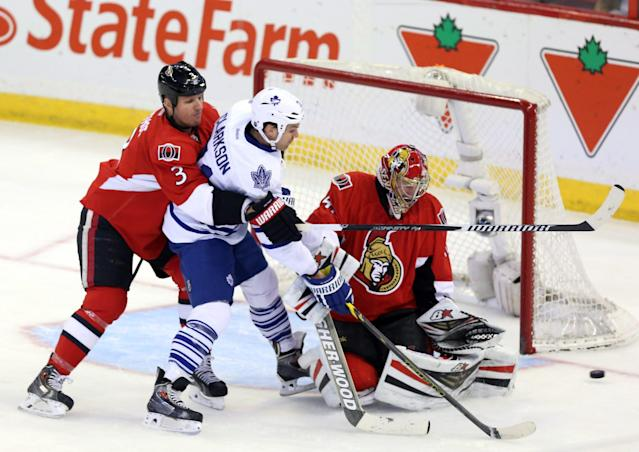 Ottawa Senators' Marc Methot (3) checks Toronto Maple Leafs' David Clarkson (71) as Senators goaltender Craig Anderson watches the puck during first-period NHL hockey game action in Ottawa, Ontario, Saturday, April 12, 2014. There was no goal scored on the play. (AP Photo/The Canadian Press, Fred Chartrand)