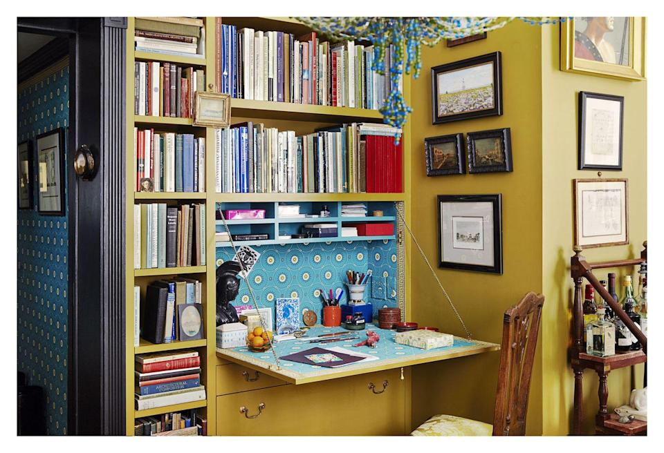 """<p>A DIY or custom fold-out desk is the best option for tiny work-from-home spaces where additional furniture just isn't in the cards. This bold yellow-and-blue version designed by <a href=""""https://brockschmidtandcoleman.com/"""" rel=""""nofollow noopener"""" target=""""_blank"""" data-ylk=""""slk:Brockschmidt and Coleman"""" class=""""link rapid-noclick-resp"""">Brockschmidt and Coleman</a> shows us that small in size doesn't necessarily translate to small in style or personality. </p>"""