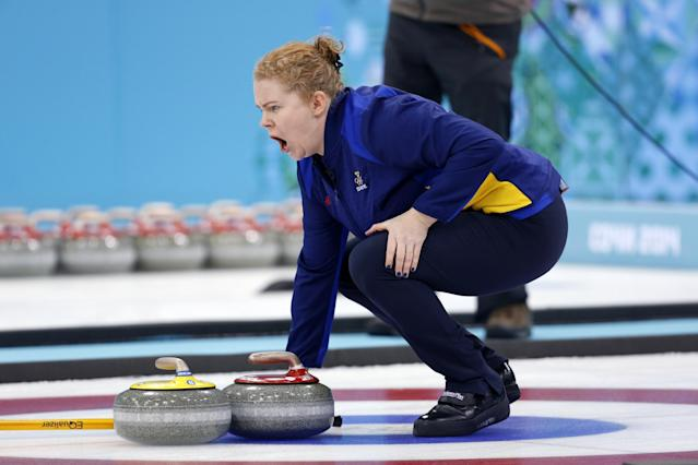 Sweden's Margaretha Sigfridsson shouts from the house to her sweepers during the women's curling gold medal game against Canada at the 2014 Winter Olympics, Thursday, Feb. 20, 2014, in Sochi, Russia. (AP Photo/Robert F. Bukaty)