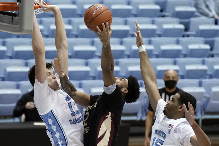 North Carolina forward Walker Kessler (13) and forward Garrison Brooks (15) guard Florida State guard Anthony Polite (2) during the second half of an NCAA college basketball game in Chapel Hill, N.C., Saturday, Feb. 27, 2021. (AP Photo/Gerry Broome)