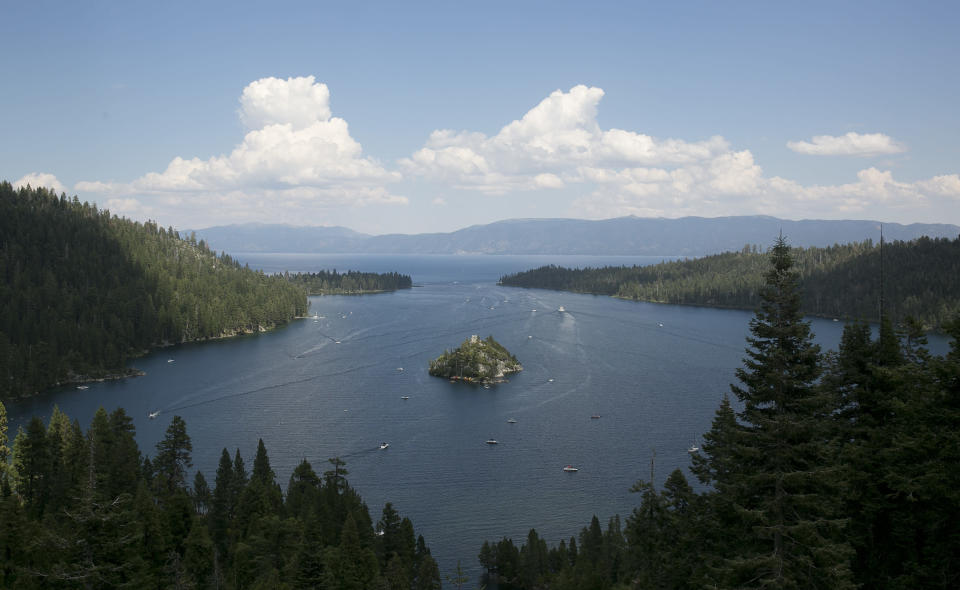 FILE - In this Aug. 8. 2017 file photo, boats ply the waters of Emerald Bay of Lake Tahoe, near South Lake Tahoe, Calif. With wildfire no longer threatening Lake Tahoe, residents, tourists and scientists drawn to its clean alpine air, clear blue waters and fragrant pine trees now wonder about the long-term effects that will remain after wildfire season ends. (AP Photo/Rich Pedroncelli, File)
