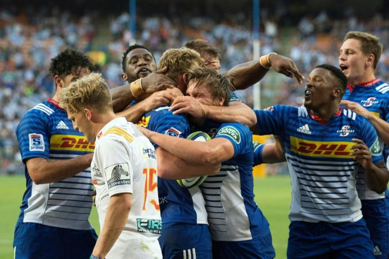 Stormers' South African fly-half Robert du Preez celebrates with his teammates after scoring a try against the New Zealand Waikato Chiefs on April 8, 2017 in Cape Town