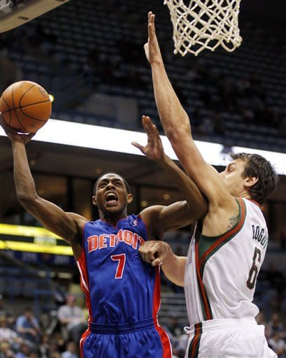 Detroit Pistons' Brandon Knight (7) drives to the basket against Milwaukee Bucks' Andrew Bogut (6) during the first half of an NBA basketball game, Thursday, Jan. 12, 2012, in Milwaukee. (AP Photo/Jeffrey Phelps)
