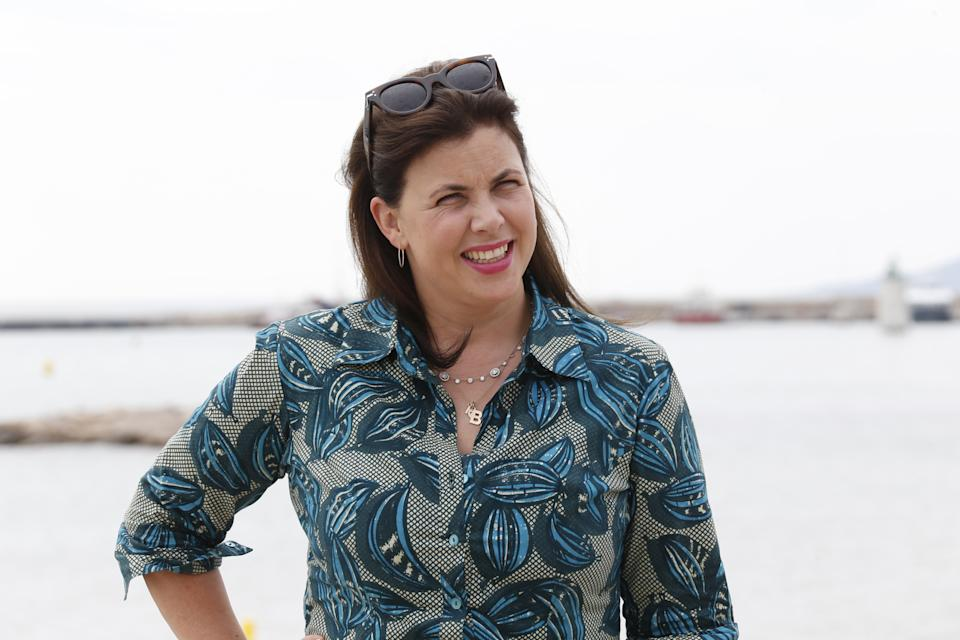 """British TV presenter Kirstie Allsopp poses for the photocall of the TV series """"Love it or list it UK"""" during the MIPCOM audiovisual trade fair in Cannes, southeastern France, on October 5, 2015. Held each year on the French Riviera, the audiovisual trade fair brings together the movers and shakers of the global entertainment business to network, talk shop and buy, sell and finance new content. AFP PHOTO / VALERY HACHE (Photo by Valery HACHE / AFP) (Photo by VALERY HACHE/AFP via Getty Images)"""