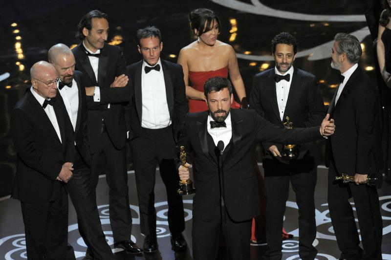 "Director/producer Ben Affleck, center, accepts the award for best picture for ""Argo,"" as the cast and crew look on during the Oscars at the Dolby Theatre on Sunday Feb. 24, 2013, in Los Angeles.  (Photo by Chris Pizzello/Invision/AP)"