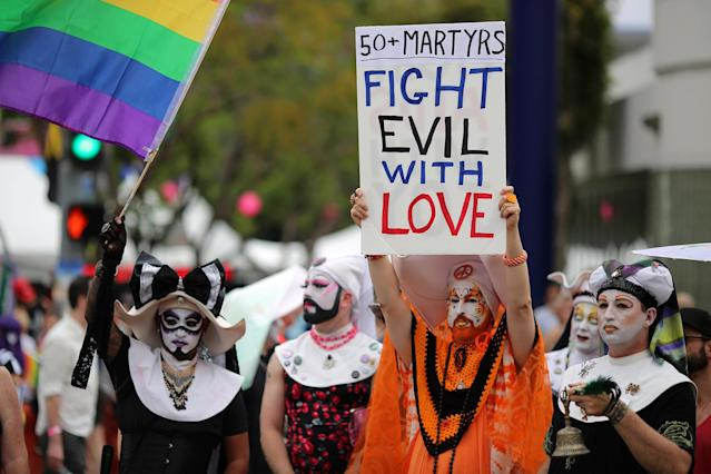 <p>Members of the Sisters of Perpetual Indulgence carry a sign of remembrance for the mass shooting victims in Orlando, at the 46th annual Los Angeles Gay Pride Parade in West Hollywood, June 12, 2016. (Reuters/David McNew) </p>