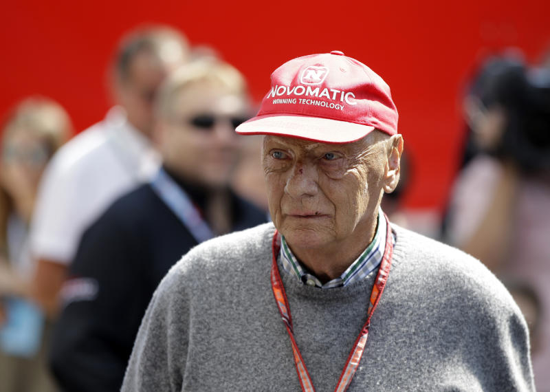 """FILE - In this July 7, 2018, file photo, former Formula One World Champion Niki Lauda of Austria walks in the paddock before the third free practice at the Silverstone racetrack, Silverstone, England. Three-time Formula One world champion Niki Lauda, who won two of his titles after a horrific crash that left him with serious burns and went on to become a prominent figure in the aviation industry, has died. He was 70. The Austria Press Agency reported Lauda's family saying in a statement he """"passed away peacefully"""" on Monday, May 20, 2019. (AP Photo/Luca Bruno, File)"""