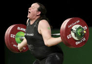 FILE - In this April 9, 2018 file photo, New Zealand's Laurel Hubbard reacts after failing to lift in the snatch of the women's +90kg weightlifting final at the 2018 Commonwealth Games on the Gold Coast, Australia. Hubbard will be the first transgender athlete to compete at the Olympics. Hubbard is among five athletes confirmed on New Zealand's weightlifting team for the Tokyo Games.(AP Photo/Mark Schiefelbein,File)
