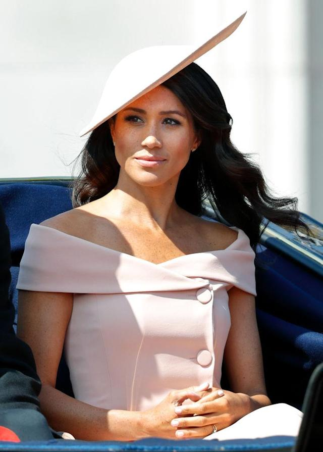 <p>Meghan Markle wears a blush off-the-shoulder dress by Carolina Herrera to the Trooping the Colour ceremony celebrating Queen Elizabeth recently. (Photo: Getty Images) </p>