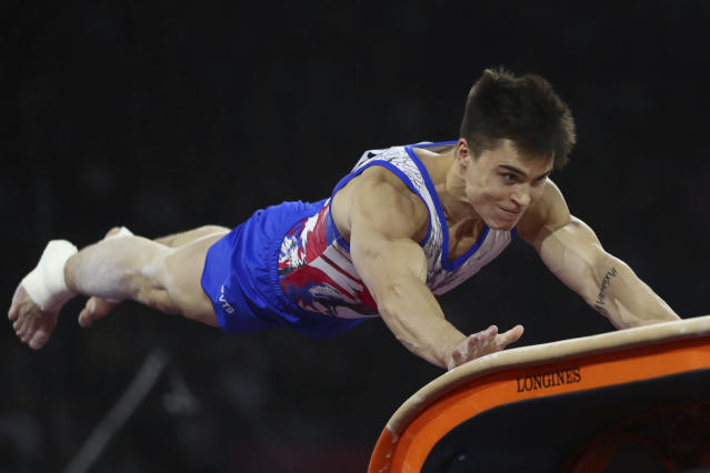 Nikita Nagornyy of Russia performs on the vault in the men's team final at the Gymnastics World Championships in Stuttgart, Germany, Wednesday, Oct. 9, 2019. (AP Photo/Matthias Schrader)