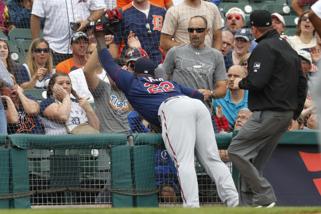 Minnesota Twins third baseman Miguel Sano (22)catches a Detroit Tigers' Niko Goodrum fly ball in foul territory for an out in the fifth inning of a baseball game in Detroit, Sunday, June 9, 2019. (AP Photo/Paul Sancya)