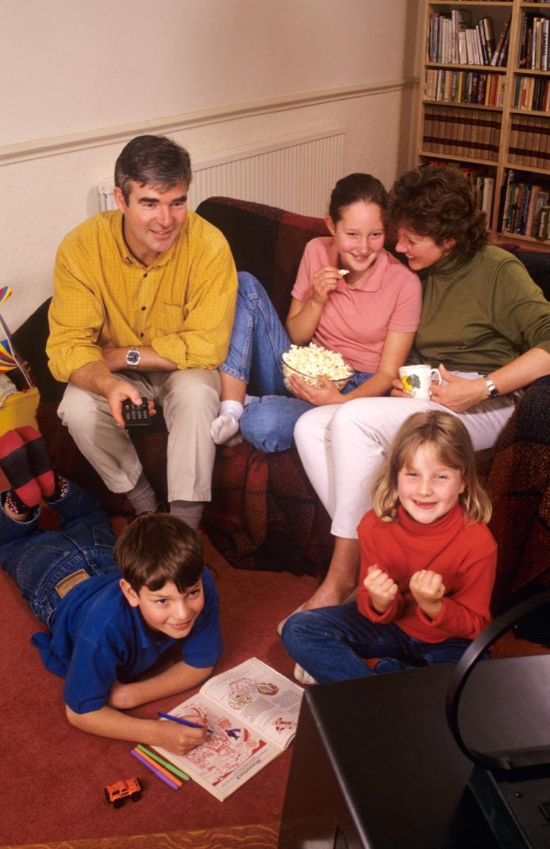 Family watching television together in the 1990s