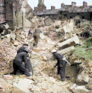 <p>Eglington Street in Belfast was destroyed following an air raid in Northern Ireland in May 1941. (MediaDrumWorld) </p>